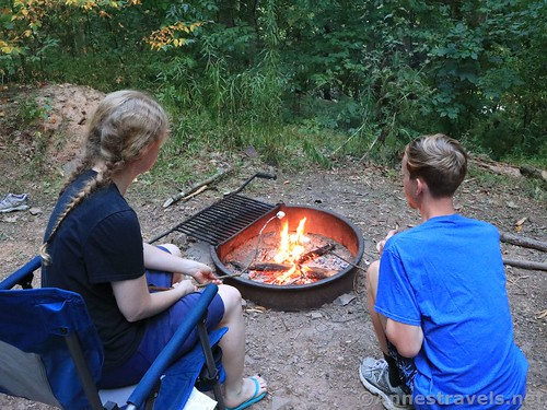 Roasting marshmallows over an open fire at a primitive campsite in Tiadaghton State Forest, Pennsylvania