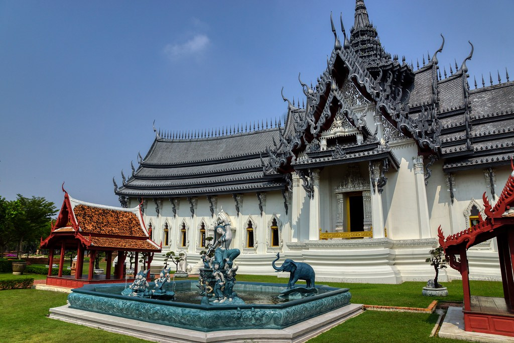 Palace replica and sculpture with fountain in Muang Boran (Ancient City) open air museum in Samut Phrakan near Bangkok, Thailand