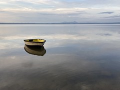 Lonely boat on the lake by cazazz