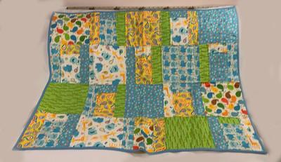 checkerd animals lap quilt