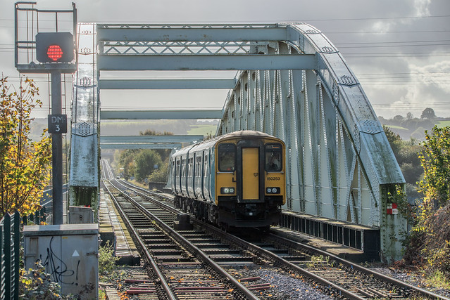 150253 rattles over Hawarden Bridge as it approaches the request stop of the same name with 2F66 1432 Wrexham Central to Bidston on 23rd October 2020