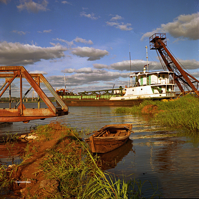 Abandoned pier and sand dredge ship