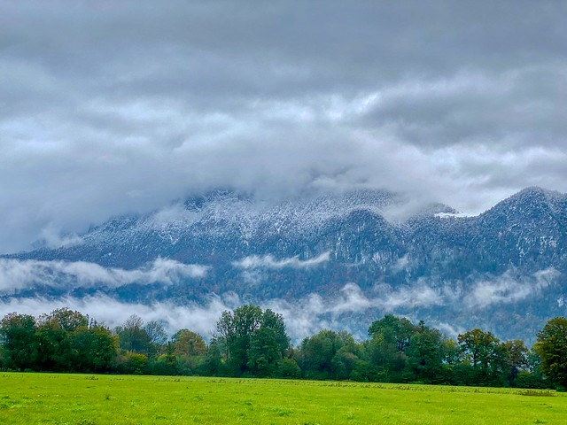 First snow on cloud covered Zahmer Kaiser mountain range seen from Kiefersfelden in the river Inn valley in Bavaria, Germany