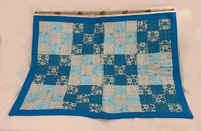 blue multi squares lap quilt