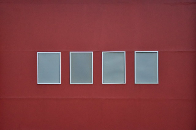 4 squares on a red wall