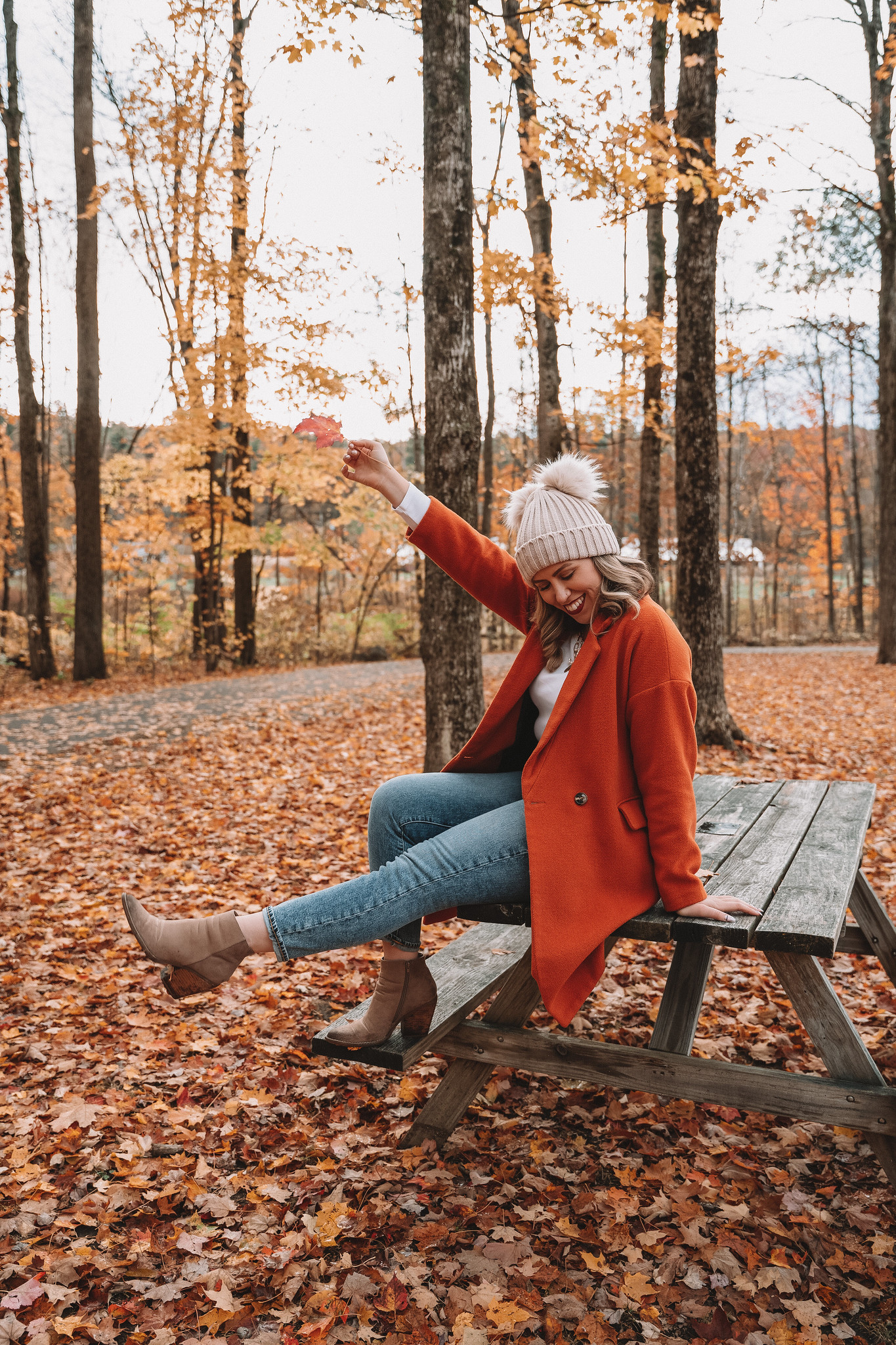 Fall Leaf Photo Prop | How to Pose with Fall Leaves | Fall Foliage Outfit | Orange Coat | What to Wear in Vermont in the Fall | Vermont Packing List for Fall | What to Wear in Vermont in October | What to Wear on a Fall Vacation | Fall Outfits