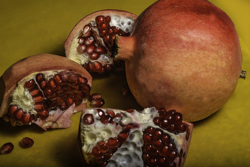 Pomegranates On A Yellow Cutting Board