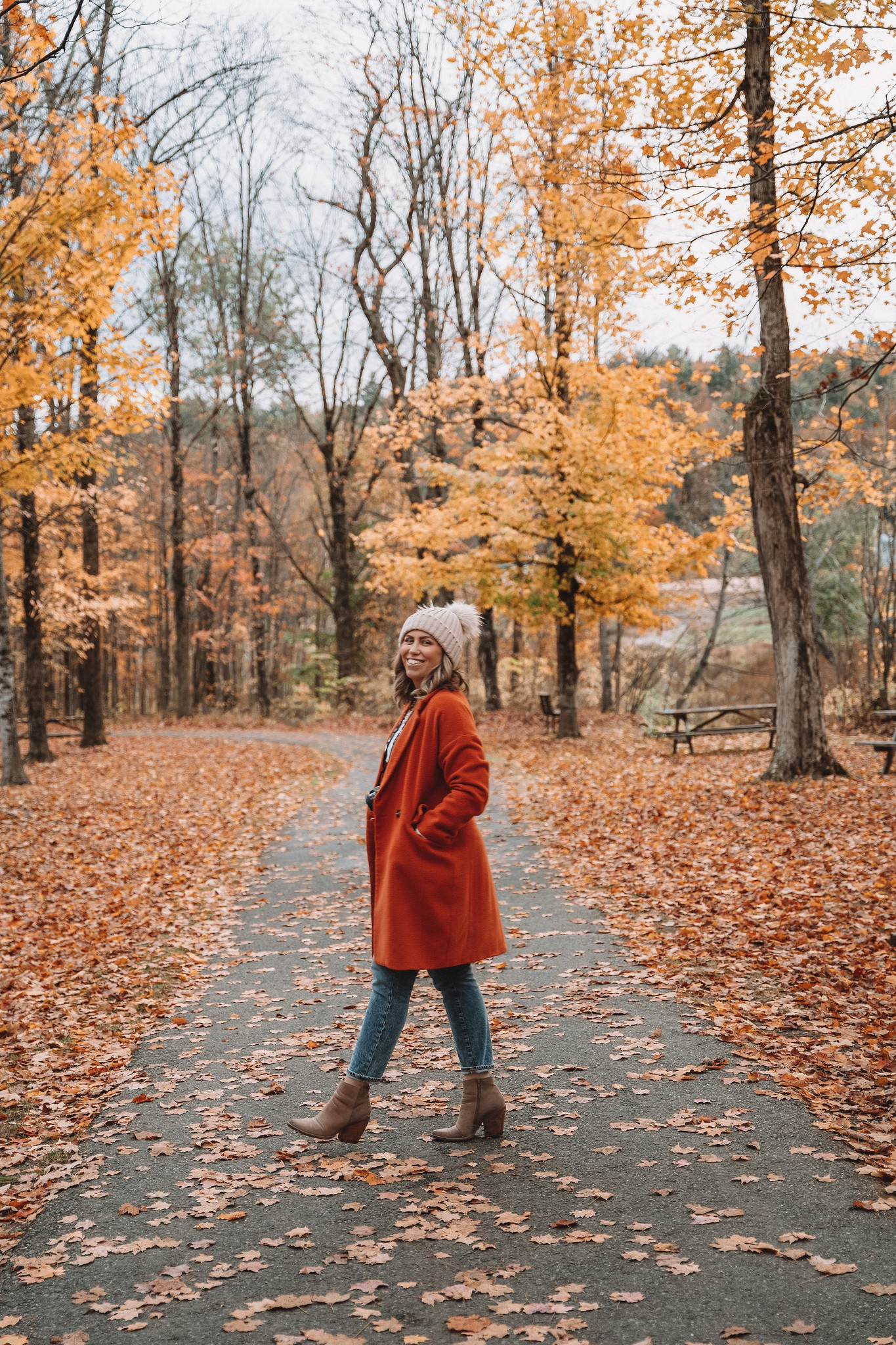 Casual Fall Outfit Inspiration with Orange Coat, Tan Booties and Pom Pom Beanie | Fall Foliage Outfit | What to Wear in Vermont in the Fall | Vermont Packing List for Fall | What to Wear in Vermont in October | What to Wear on a Fall Vacation | Fall Outfits