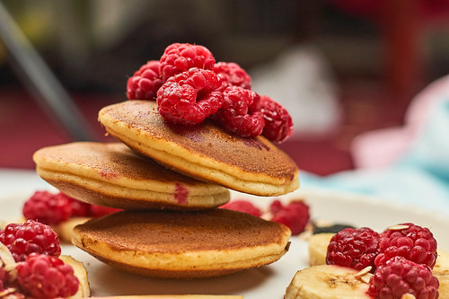 Close-up view of sweet dessert with pancakes and raspberries