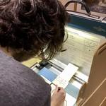 Florida voting machine from 2000 - hanging chads.