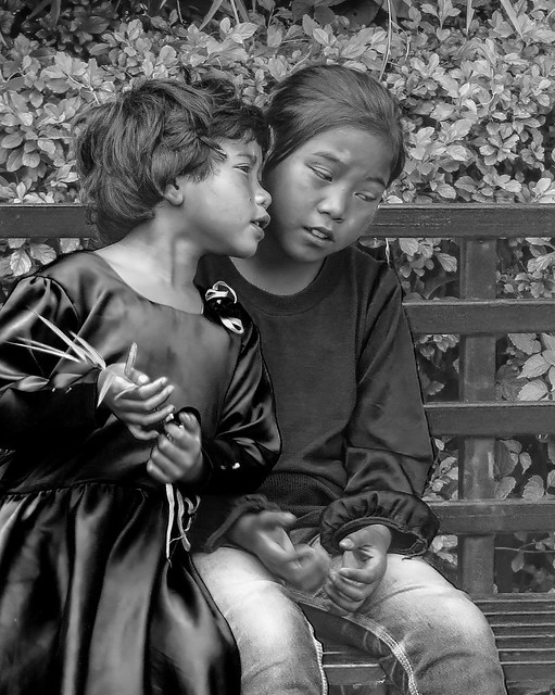 Two young Khasi girls share a tender moment...