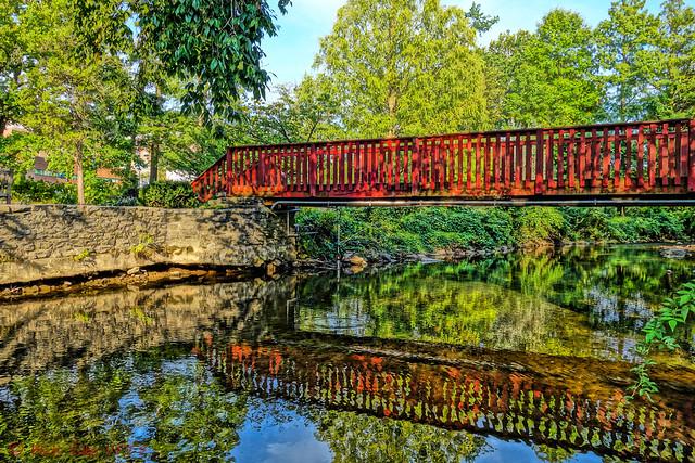 Red Foot Bridge Into Perennial Garden