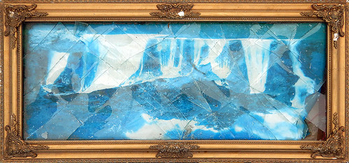 The cracked glass on a gilt framed old photo