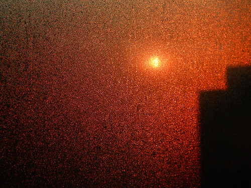 Red sun in the morning through my fogged up windows hint at another smokey day outside
