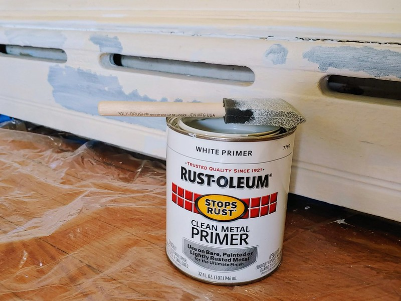 Painting the Den: Rustoleum Clean Metal Primer goes on all the chipped baseboard radiators
