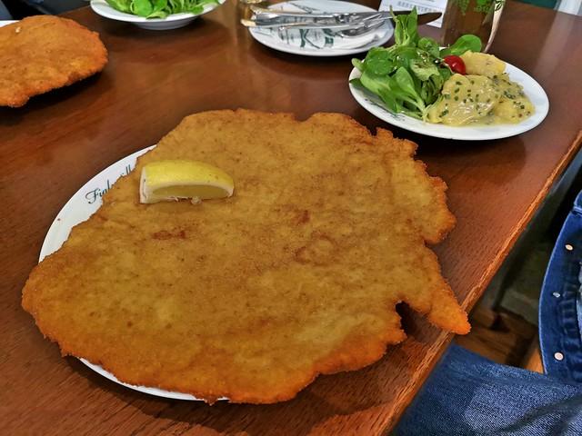 A Schnitzel bigger than its plate.
