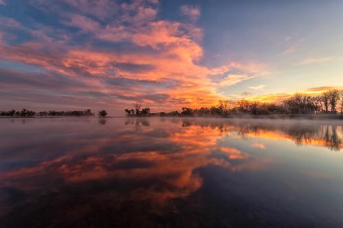 sunrise dawn daybreak clouds trees lake reflections mist landscape lakechatfield chatfieldstatepark colorado landscapes