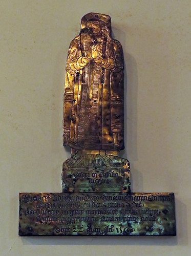 Brass figure on the wall of the church in Ruthin, Wales