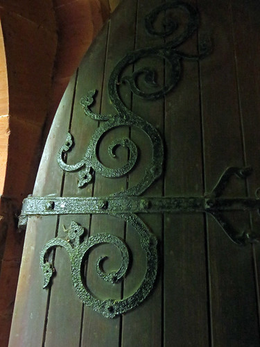 Door with wrought iron hinges leading into the church in Ruthin, Wales