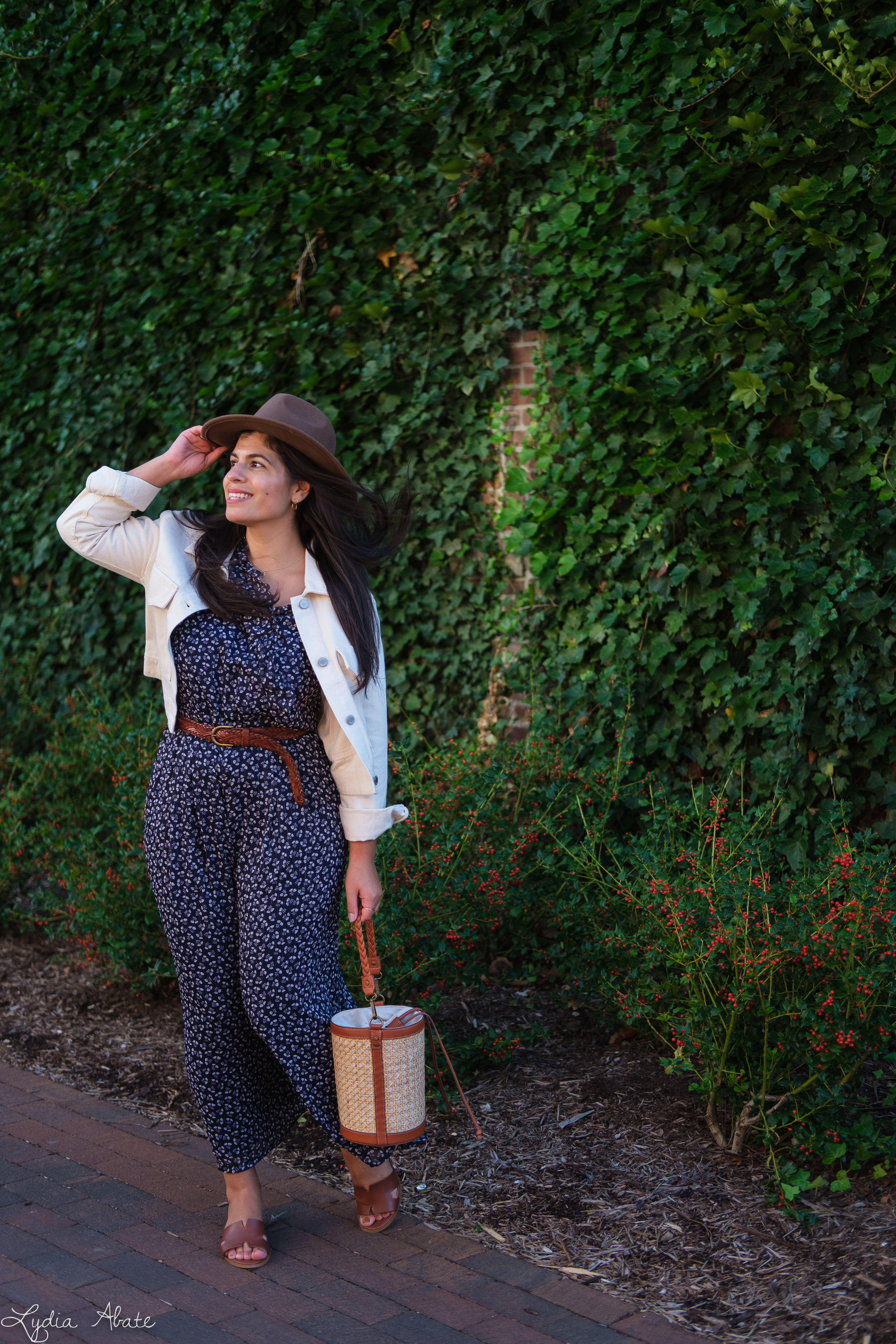 blue floral jumpsuit, cream cropped denim jacket, brown felt fedora, caning bag-7.jpg