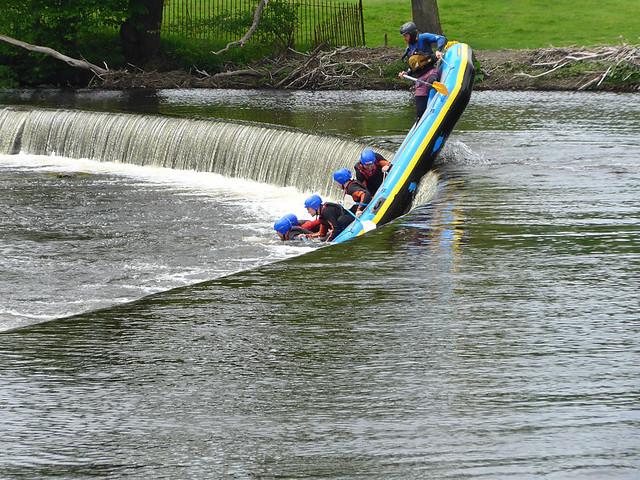 Rafters attempting to negotiate the 'falls' part of Horseshoe Falls in Llangollen, Wales