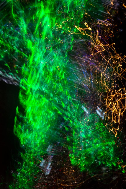 City lights at night. Light painting with camera. Abstract background.