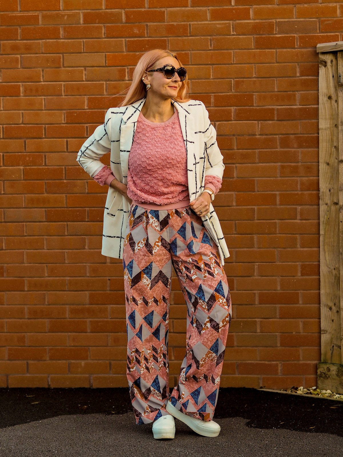 A Quick Guide to Mixing Patterns | Not Dressed As Lamb, Style Over 40 (outfit: black and white longline windowpane check jacket, pink and navy patterned wide leg trousers, pink fluffy sweater, white flatform trainers. oversized leopard sunglasses)