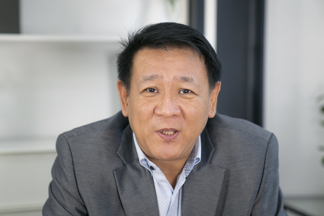 portrait of senior asian businessman talking in meeting room
