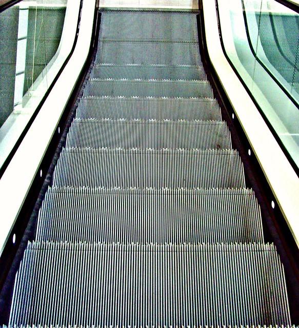 Down the down escalator