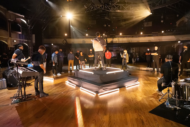 HENDERSONVILLE, TN - SEPTEMBER 16:  Jonathan McReynolds w/2020 Dove Awards Production Crew prays onstage during the 2020 Dove Awards at TBN Studios on September 16, 2020 in Hendersonville, Tennessee.  (Photo by Don Claussen/Trap The Light Photography for