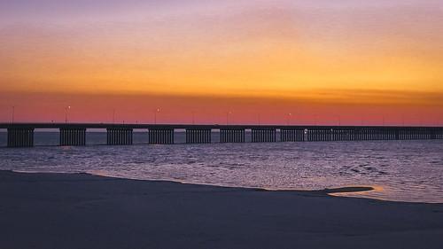 morning baysaintlouismississippi sand sunrise mississippigulfcoast baysaintlouis dawn bayofsaintlouismississippi mississippi beach bridge baysaintlouisbridge
