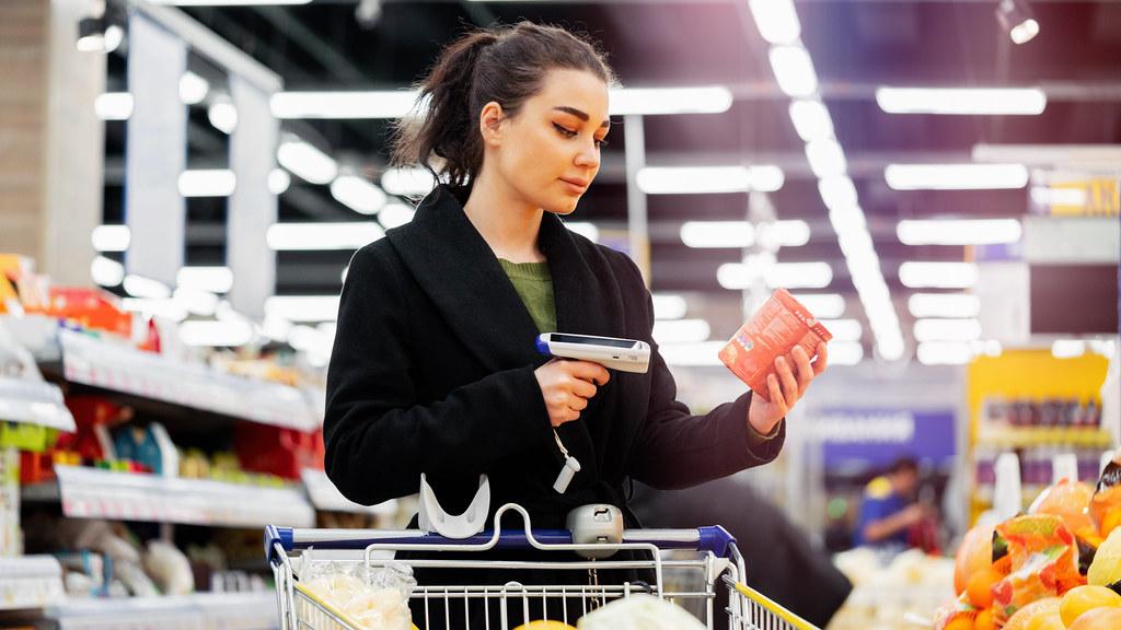 Woman using handheld scanner Photo Credit Abobe Stock