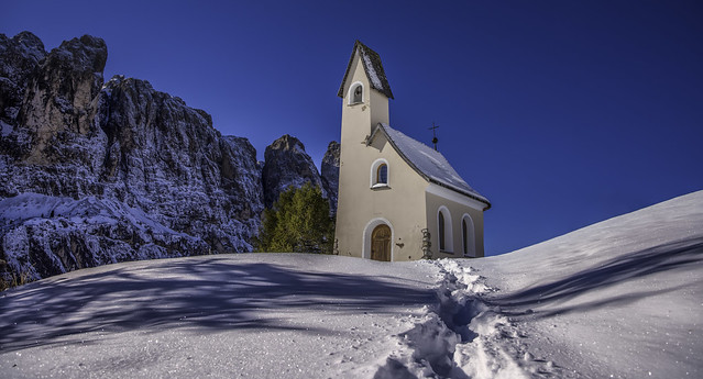 Dolomites...little church with early snow...