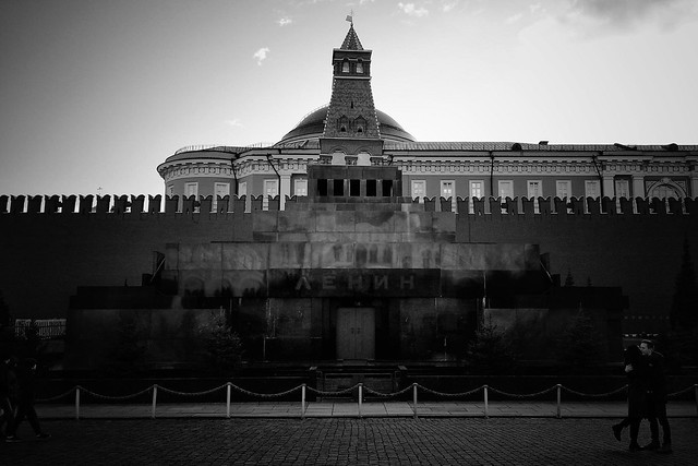 A black and white photo shows the concrete wall surrounding Lenin's Mausoleum.