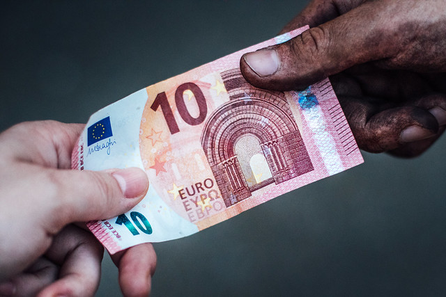 Employer paying 10 euros for employee's labor. Manual workers are often underpaid