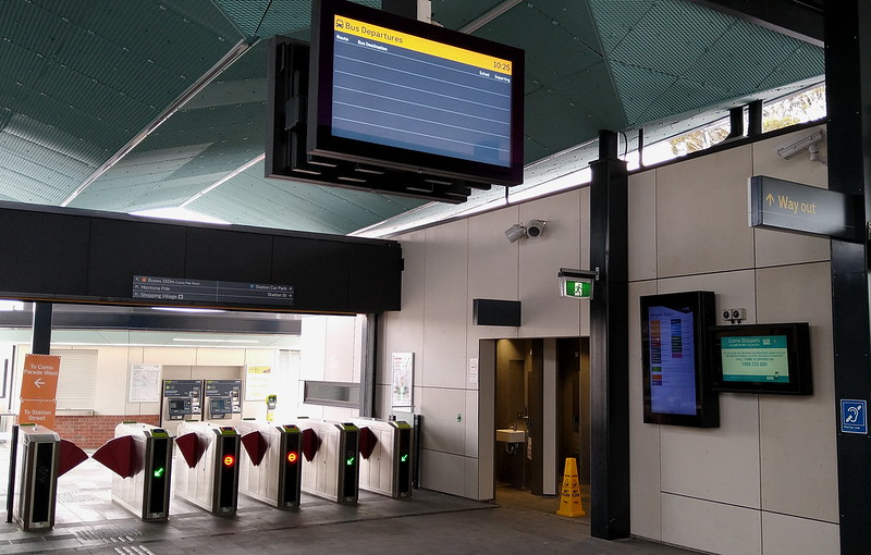 Mentone station concourse, showing bus departures screen