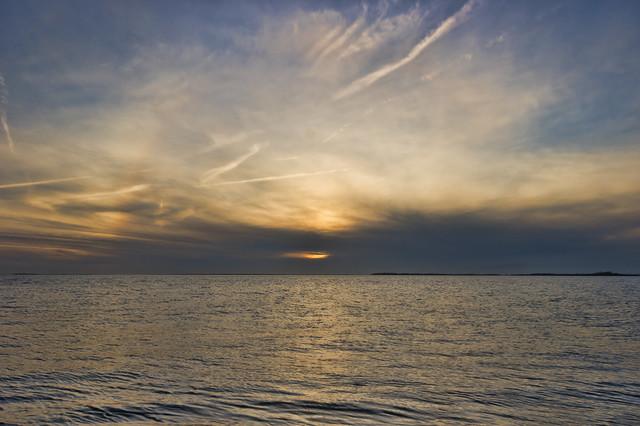 Coastal sunset with a halo