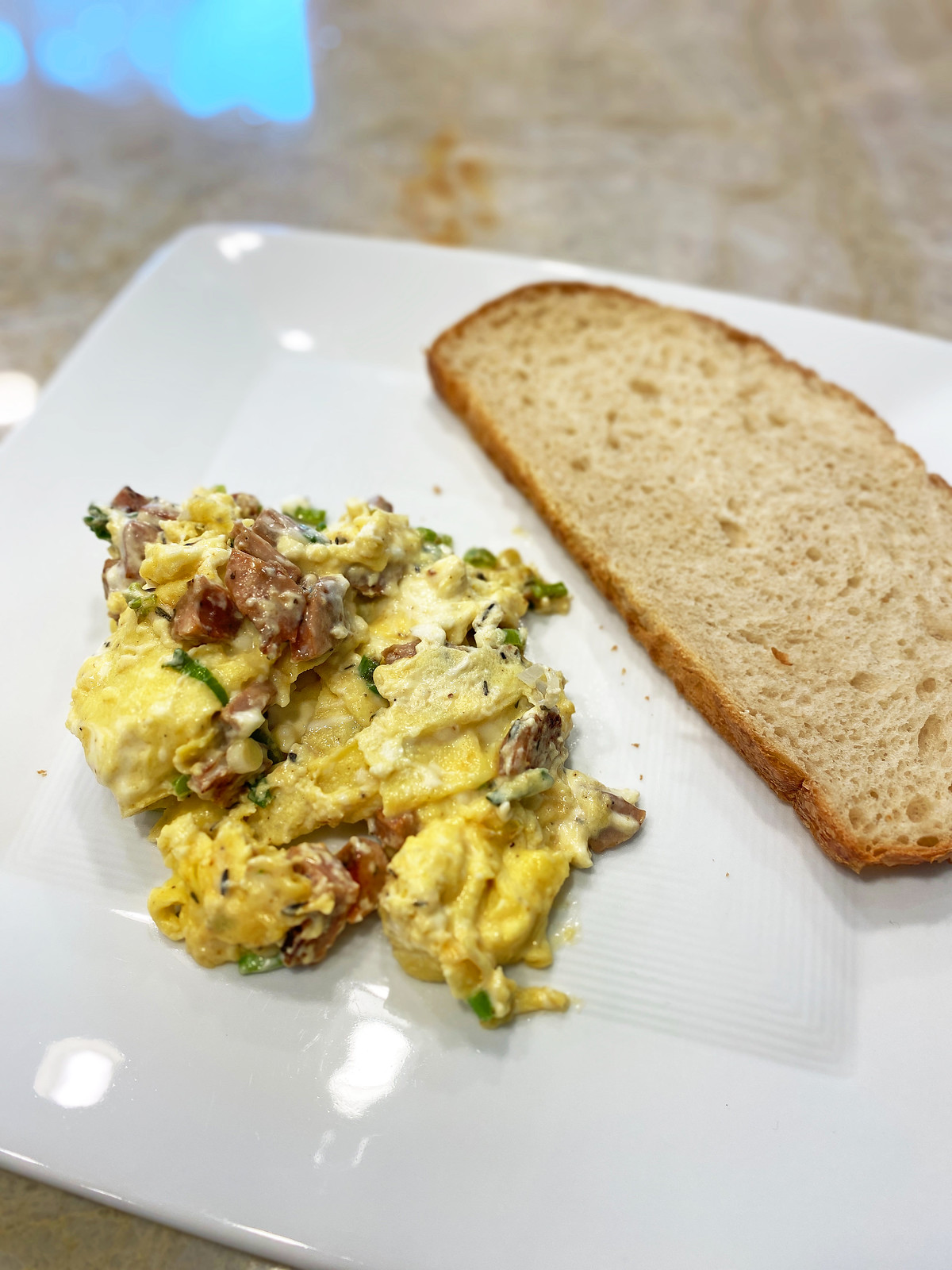 Scrambled eggs with sausage and thyme