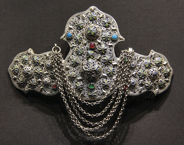 Belt clasp (poukla), Cyprus, 1800-1900, silver filigree with enamel and coloured glass