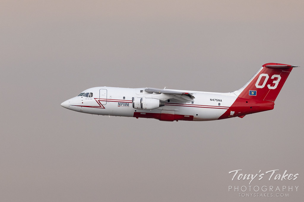 Neptune Aviation BAe 146 airtanker departs to battle the Colorado wildfires. (© Tony's Takes)