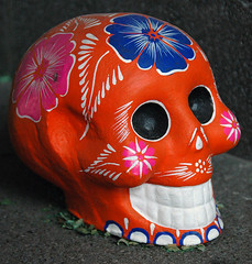 Decorated orange skull for the Day of the Dead in Mexico