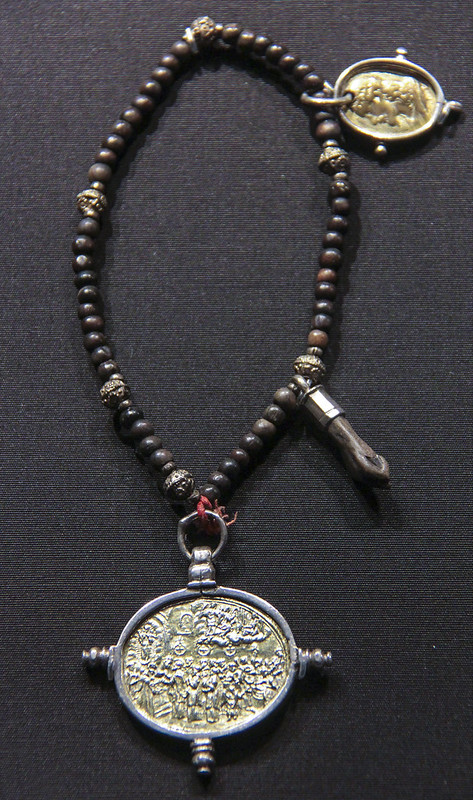 Rosary, Switzerland or Austrian Tyrol, 1750-1800, wood and silver beads with a Neidfeige amulet and gilded pilgrimage medals, one from Einsiedlen
