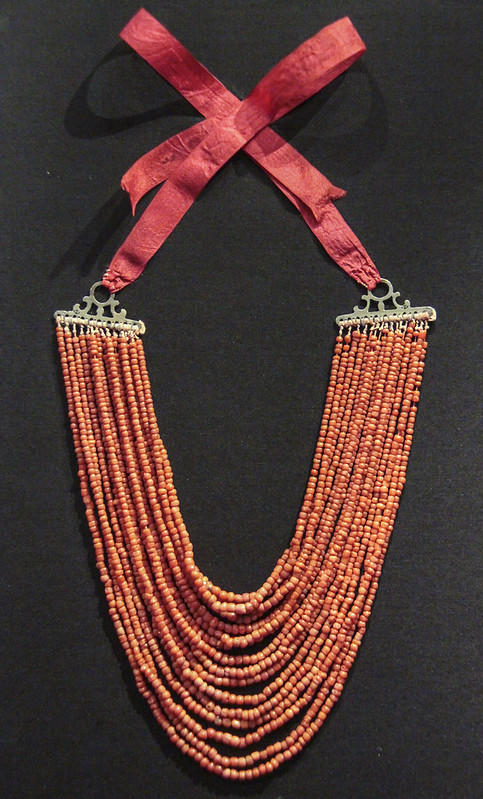 Necklace, Italy, 1820-60, coral beads with silver terminals and red ribbon