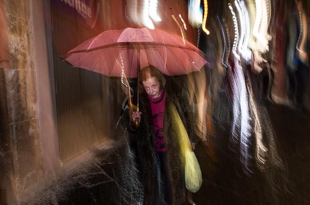 Elderly woman with umbrella