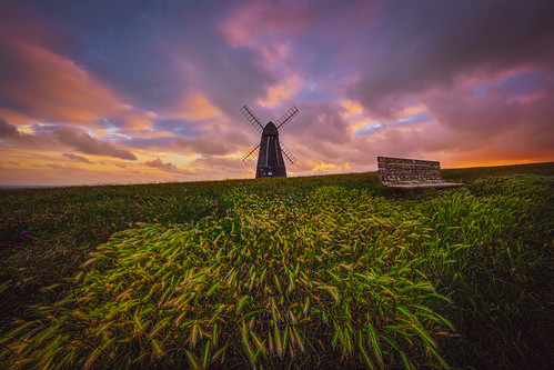 rottingdean windmill sunset clouds bench grass uk sussex england