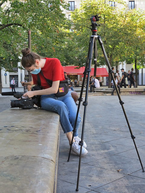Girl filming the surroundings of the Place des Innocents