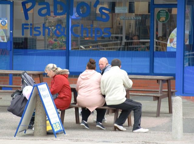 People huddled together on the front at Blackpool