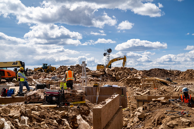 Colorado, USA - September 15, 2020: Construction workers and crew work in the rubble at the top of Pikes Peak Colorado. A new visitor center is under construction