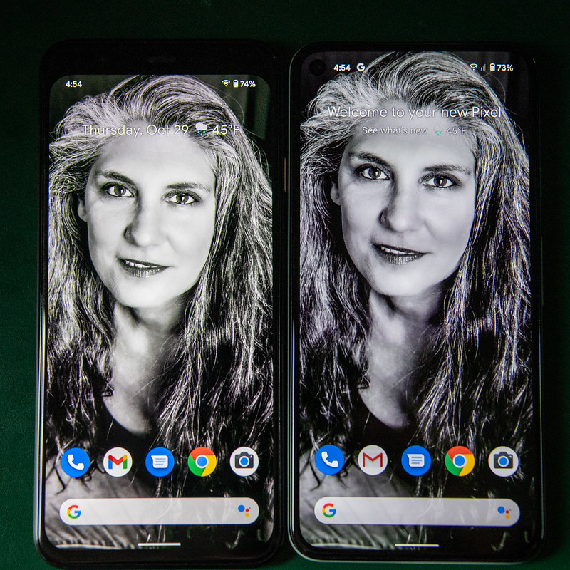 The Pixel 4 and the Pixel 5 side by side. They are about the same size but the Pixel 5 has a noticeably larger screen.