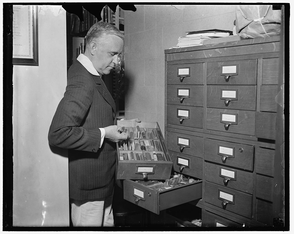 Identified! V. Valtra Parma, [Library of Congress Rare Book Division curator with a collection of miniature books] (LOC)
